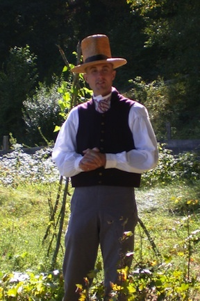Historic interpreter in the farm at Old Sturbridge Village