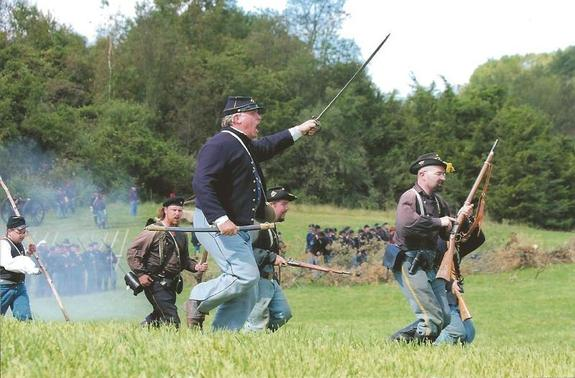 Union troops charge at the Confederate forces on the battleground at Chase Farm Park