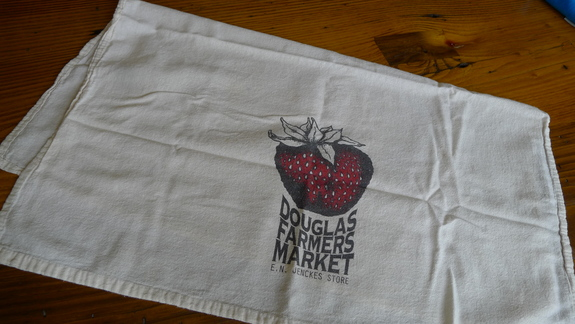 The dish towel sold to support the Douglas Farmers Market at the E. N. Jenckes Farmers Market in Douglas, Massachusetts