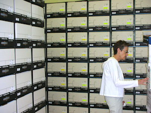 Staff member among stacks in Archive